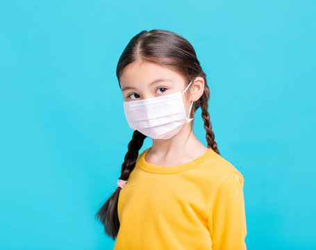 sick Girl child in medical mask isolated on blue background
