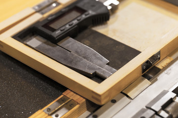 Electronic caliper lays in a wooden box