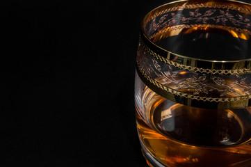 Glass of dark red whiskey, brandy or .bourbon