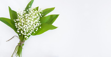 Beautiful bouquet of lilies of the valley on white background. Space for text, flat lay