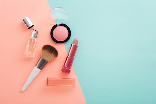 Cosmetic beauty products on pastel color background