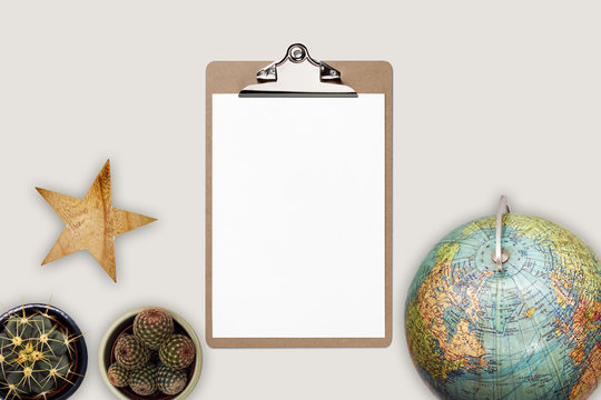 Flat lay top view World travel concept with clipboard and beige background
