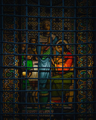 Tuinposter Imagination Beautiful glass of Montserrat with religious images in front of a fence