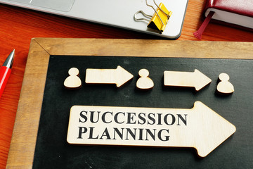 Succession planning concept. Wooden figures and arrows.