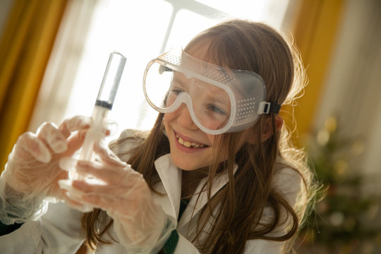 Little girl having fun while doing science experiments