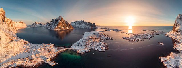 Sunrise on Lofoten island is archipelago with fishing village on coastline in winter at Norway