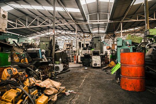 old grunge used machinery workshop garage or heavy machine junkyard warehouse danger workplace.