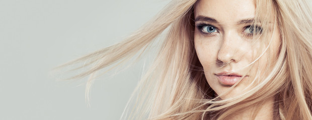 Keuken foto achterwand Kapsalon Beauty woman face. Model girl with blowing hair close up portrait. Long health hairstyle, natural skin