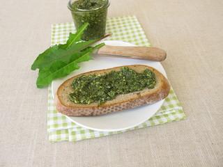 Dandelion pesto, green pesto with dandelion on a slice of bread
