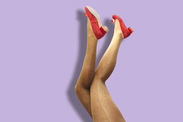 Sexy woman legs in gold tights and shoes over purple background. Collage in magazine style, pop art collection.