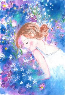 青い花に囲まれた幸せな女の子