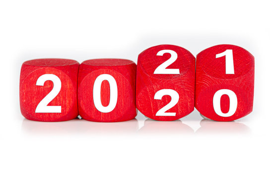 wooden cube with year 2020 and 2021 built from red dices, isolated on white background