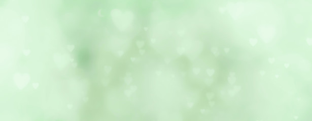 Fototapete - abstract background with soft bokeh and green hearts