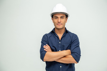 Handsome man industrial engineer wearing a white helmet solated on white background