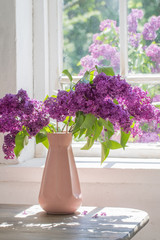 Poster Lilac lilac in vase against the window on a sunny day