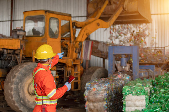 Large waste management industry By the foreman in the factory wearing uniforms for safety and accuracy of work