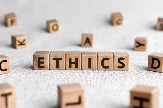 Ethics - words from wooden blocks with letters, ethics moral philosophy concept, white background