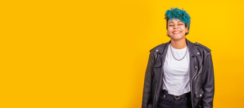 portrait of young afro american woman isolated on color background