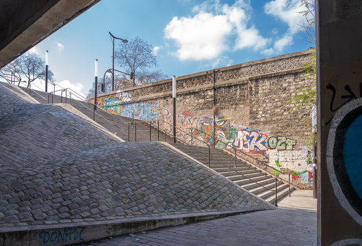 Paris, France - 04 14 2019: Canal Lourcq. Staircase in the morning light