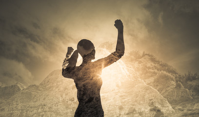 Strong determined female with hand raised to the sky. People power, victory concept