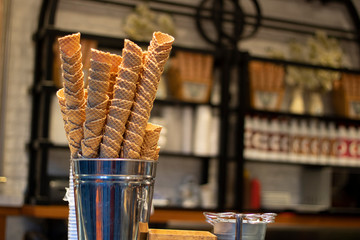 Close-up photo of cones in front of the ice cream shop.