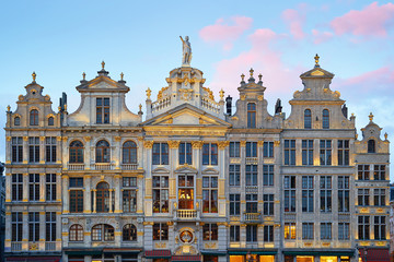 Foto op Canvas Brussel Brussels Grand Place. North-east part. Sunset evening view of row of old beautiful stone buildings facades between Rue de la Colline and Rue des Harengs. Lots of artistic golden details and