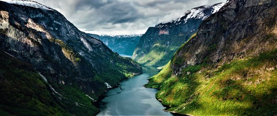 Panorama of beautiful valley with mountains and river in Norway