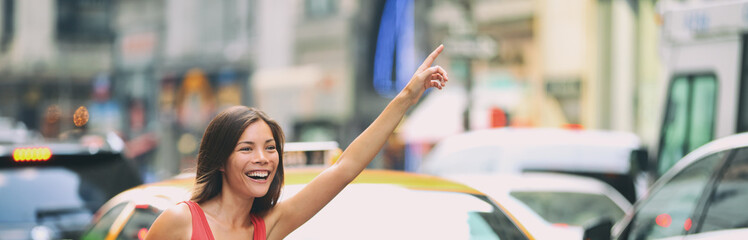 Hailing a taxi cab ride in New York City header. Asian woman with hand up for rideshare car in...