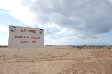 A welcome sign board is seen at the entrance of Zueitina oil terminal, in west of Benghazi