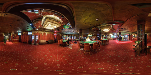 MINSK, BELARUS - FEBRUARY, 2017: panorama 360 angle view in interior elite luxury casino with croupiers girls in red style. full 360 degree seamless panorama in equirectangular spherical projection.