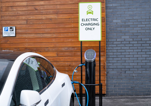 Electric car charging at public recharging point in UK