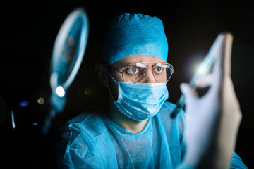 Scientist doctor examining sample of virus in laboratory