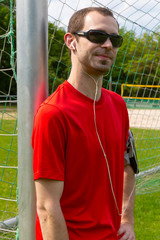 Sportsman with sunglass and earphones
