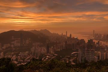 Fototapete - Skyline of Hong Kong city under sunset