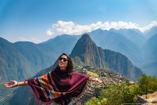 Woman enjoying the view of Machu Picchu Peru South America