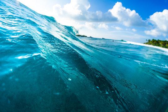 Ocean wave breaks over the coral reef