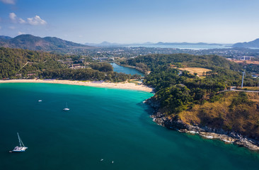 Wall Mural - Aerial view of Nai Harn beach during high season, Phuket island, Thailand