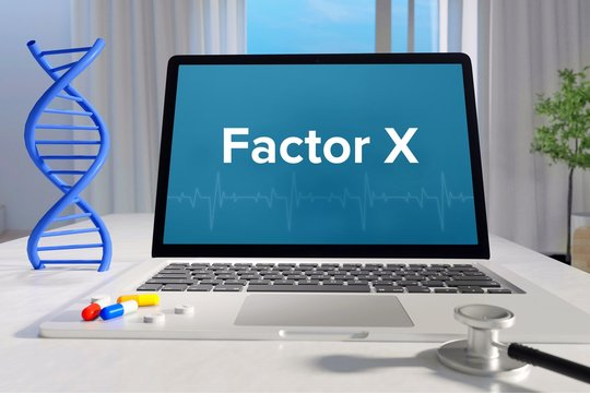 Factor X – Medicine/health. Computer in the office with term on the screen. Science/healthcare