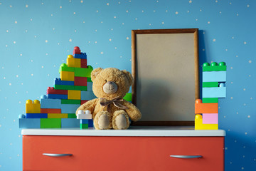 wooden photo frame and toys