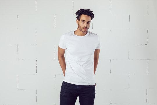African american man wearing white blank t-shirt. Mock-up.