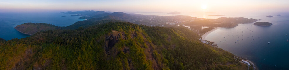 Wall Mural - Aerial panorama of the west coast of Phuket island and its beaches at sunrise. Thailand
