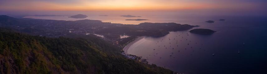 Wall Mural - Aerial panorama of Phuket island and Nai Harn beach before sunrise. Thailand