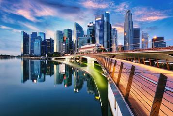 Fotomurales - Singapore city skyline at sunset  with bridge