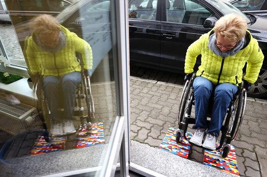 "Rita Ebel, nicknamed ""Lego grandma"", tests one of her wheelchair ramps built from donated Lego bricks in Hanau"