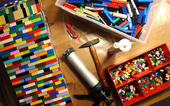 """Donated Lego bricks and tools needed to build a wheelchair ramp are seen in the living room of """"Lego grandma"""" Rita Ebel at her flat in Hanau"""