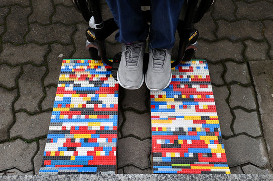 "Rita Ebel, nicknamed ""Lego grandma"" tests one of her wheelchair ramps built from donated Lego bricks in Hanau"
