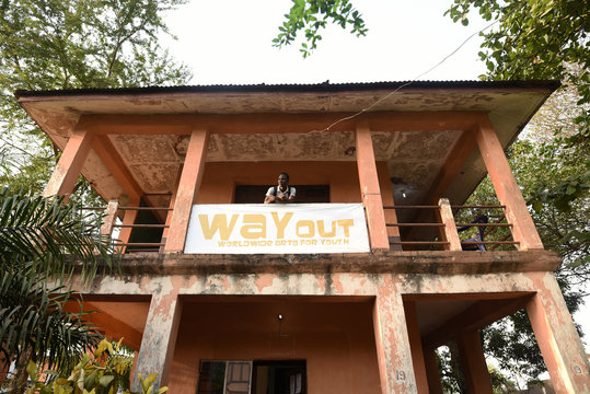 Way Out member Milton Kanu stands on the balcony of the eponymous media studio in Freetown,