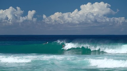 Wall Mural - Waves break at the Banzai Pipeline surf spot on Oahu island in Hawaii