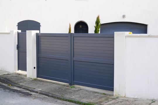 steel big grey metal gate fence on modern house street