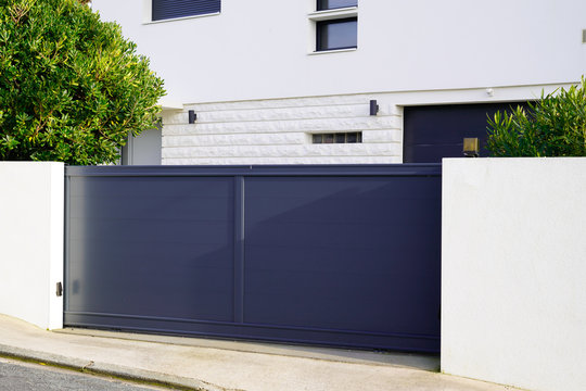 metal gate grey home fence on suburb street house
